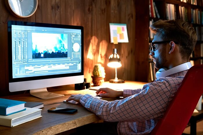 male videographer editing video footages